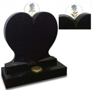 Heart shaped memorial cradles exclusive carved glass discs, reverse gilded in both palladium and gold leaf. Shown in polished Galaxy Black granite