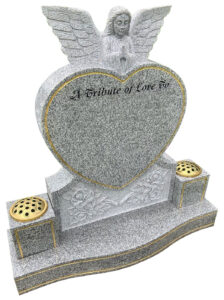 Light grey grantie heart shaped headstone with Carved praying Angel at top of heart