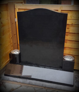 All Polished Black Granite Headstone with two block vases and full splay to base of headstone